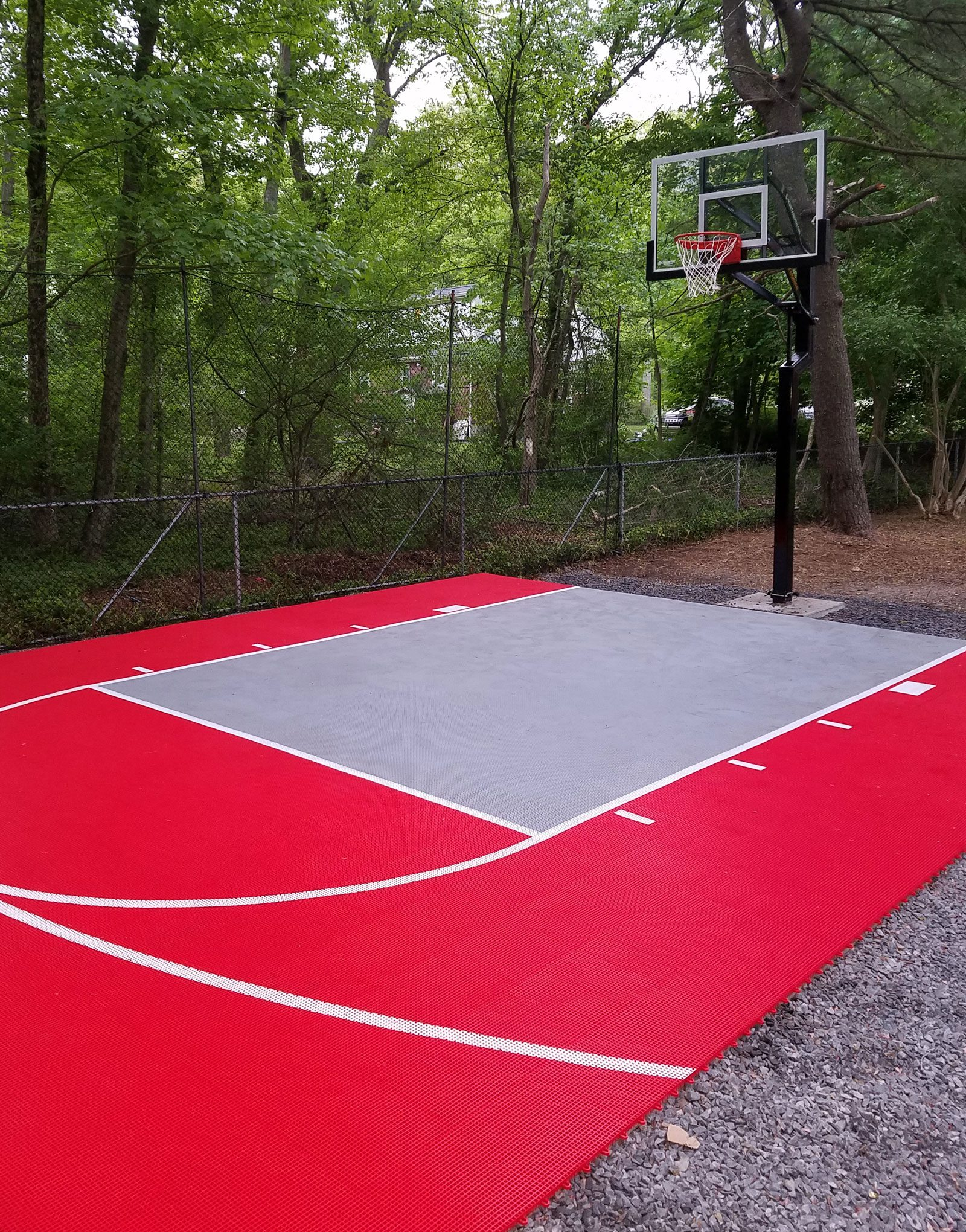 Red and gray backyard basketball court