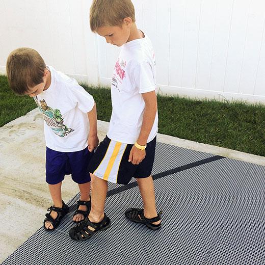 Kids installing an easy-to-install DunkStar court