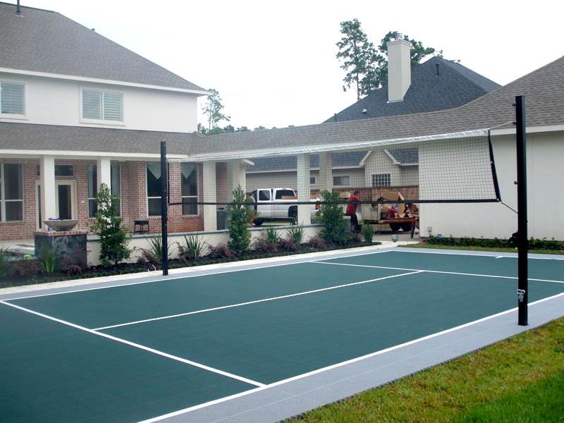 Evergreen and gray backyard volleyball court