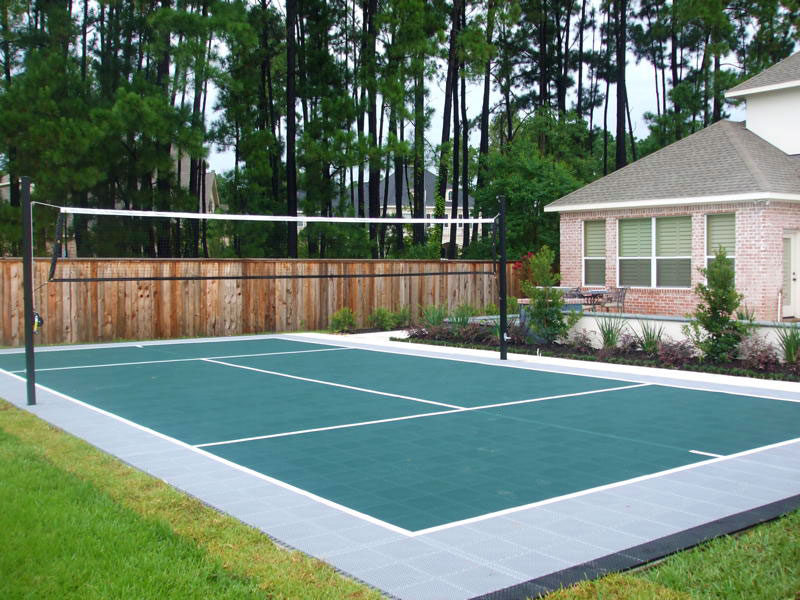 Backyard volleyball court in evergreen and gray