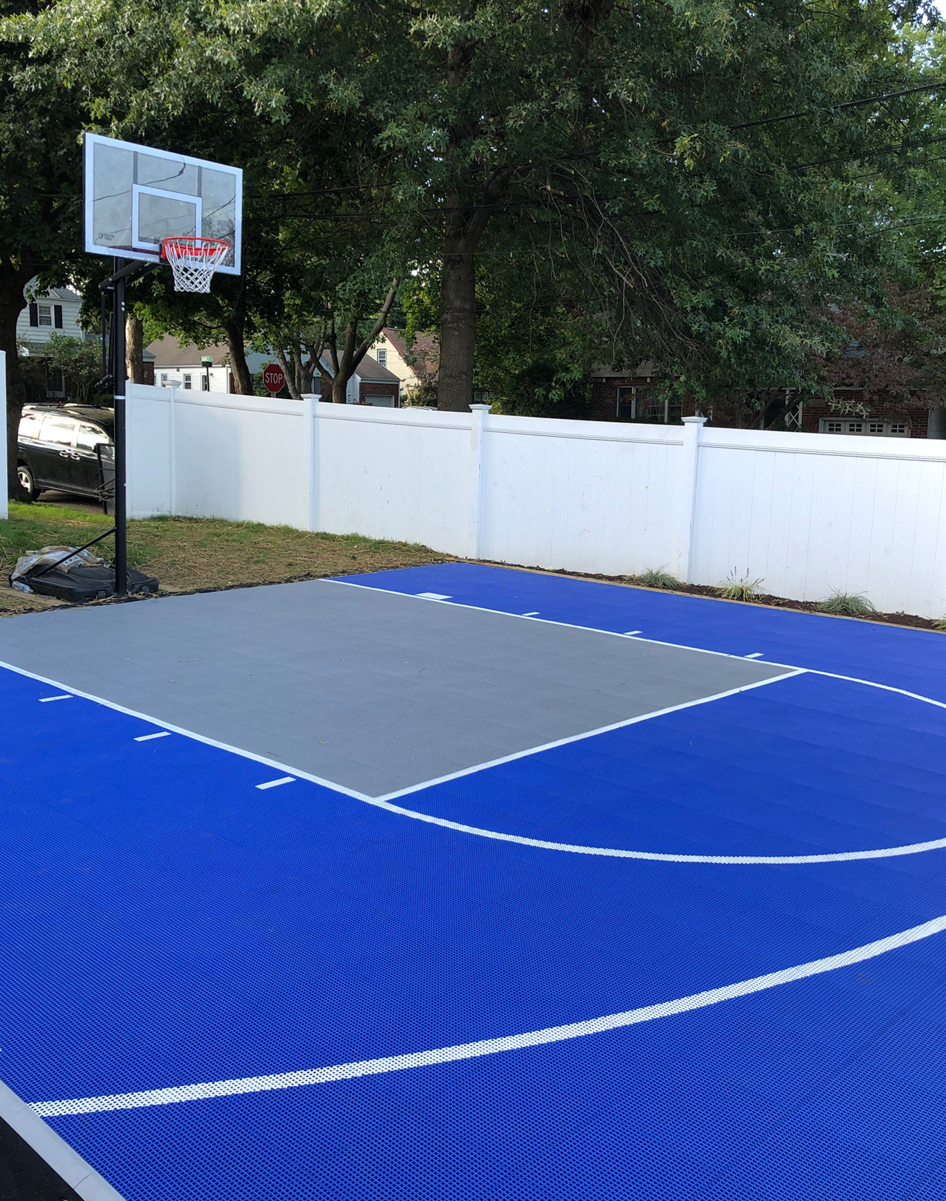 Bright blue and gray basketball half court