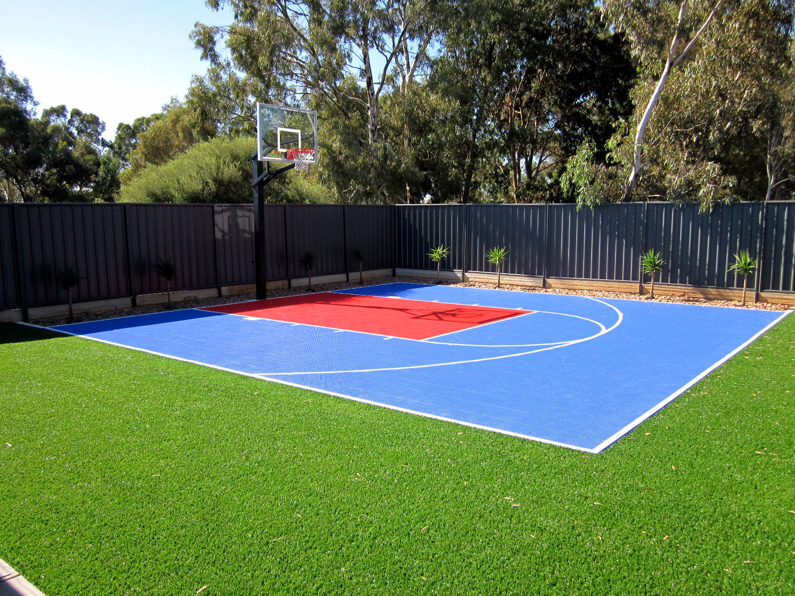 Small basketball half court in bright blue and red