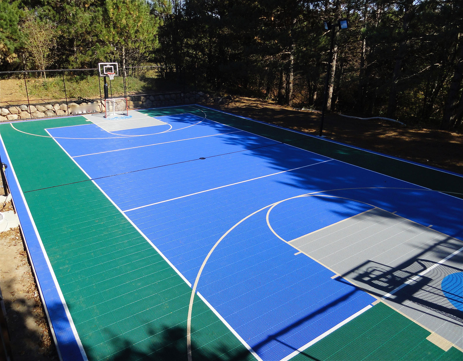 Full multi-court in evergreen, bright blue and gray with hockey lines