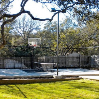 Gray half multi-court with fencing