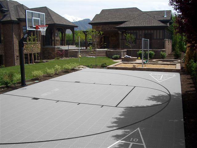 Gray half-court with basketball and custom shuffleboard lines