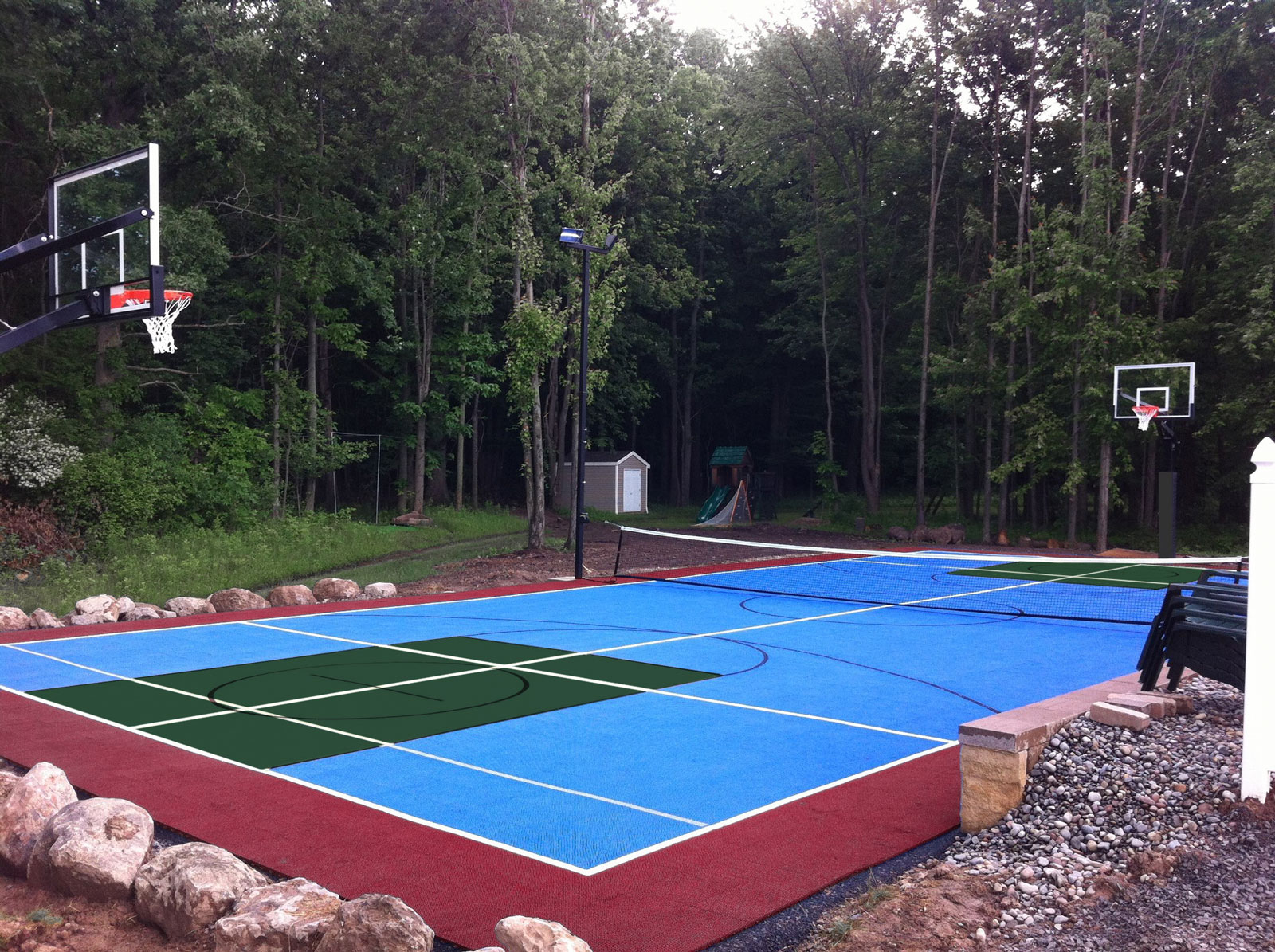Multicolored multi-court with nets, hoops, and lights